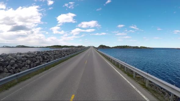 Driving a Car on a Road in Norway Atlantic Ocean Road or the Atlantic Road