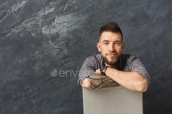 Handsome smiling man posing in studio