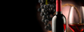 Wine. Bottle and glass of red wine with ripe grapes over black b - PhotoDune Item for Sale