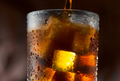 Cola pouring in glass with ice cubes over dark background - PhotoDune Item for Sale