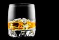 Whisky on the rocks. Glass of whiskey with ice isolated on black - PhotoDune Item for Sale