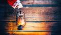 Christmas scene. Santa Claus hand holding vintage oil lamp over - PhotoDune Item for Sale