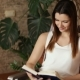 Young Beautiful Girl Reading a Book Sitting in a Chair Attractive Woman Smiling While Reading a - VideoHive Item for Sale