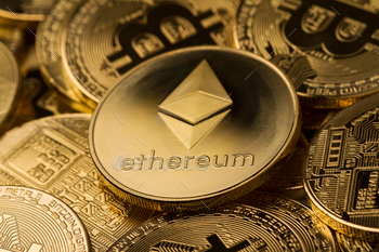 close up of ethereum on a stack of bitcoin golden coins