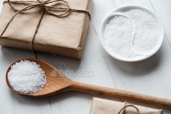 Healthy Sea Salt on white wooden table with copyspace
