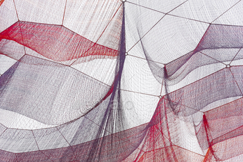 Red and purple nets under the ski. Textured background. Horizontal