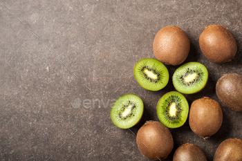 Fresh kiwi fruits on stone table