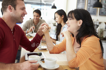 Romantic Couple Meeting In Busy Café