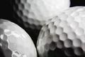Golf ball on black background - PhotoDune Item for Sale