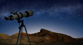telescope on a tripod pointing at starry night sky - PhotoDune Item for Sale