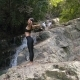 Young Woman Meditates at the Waterfall - VideoHive Item for Sale