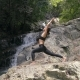 Asian Woman Practicing Yoga at the Waterfall - VideoHive Item for Sale