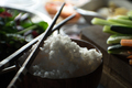 Chopsticks, rice and vegetables for cooking sushi top view. Asian cuisine - PhotoDune Item for Sale