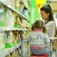 Side View of Beautiful Brunette Woman with Little Cute Girl Standing Near Shelf With Goods. Happy - VideoHive Item for Sale