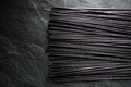 Black dry rice noodles on black stone free space - PhotoDune Item for Sale