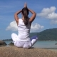 Young Woman Meditates at the Sea - VideoHive Item for Sale