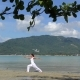 Woman Practicing Yoga at the Sea on Tropical Island - VideoHive Item for Sale