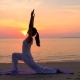 Asian Woman Practicing Yoga at the Sunset Sea - VideoHive Item for Sale
