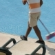 Worker Is Cleaning the Water Pool with Brush - VideoHive Item for Sale
