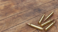 Rifle Ammunition on Old Wooden Boards - PhotoDune Item for Sale