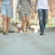 Three Friends are Walking on Pavement at Midday. They are Having Fun at This Sunny and Heat Weather - VideoHive Item for Sale