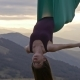 Woman in Hammock Meditating Upside Down at Sunset - VideoHive Item for Sale
