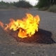 A Pair of Female Shoes in Fire on an Empty Road - VideoHive Item for Sale