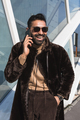 Young Indian man talking on phone - PhotoDune Item for Sale