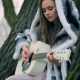 Portrait of a Girl Plays Guitar Sitting on a Big Old Tree in Picturesque Forest - VideoHive Item for Sale