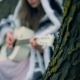 Beautiful Caucasian Teen Girl Pays Guitar Sitting on a Tree - VideoHive Item for Sale