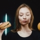 Hamburger or Orange. What To Choose. She Has a Problem. Girl on a Diet. The Woman Is Trying To Lose - VideoHive Item for Sale