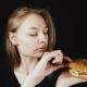 Bad Hamburger. Poor Food. The Girl Looks at the Hamburger in Disgust. Bad Fast Food - VideoHive Item for Sale