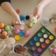 Colorful Easter Eggs on the Table. Woman Colored Eggs for Easter with Brush. - VideoHive Item for Sale