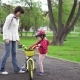 Mother Teaches Little Daughter To Ride a Bicycle. - VideoHive Item for Sale