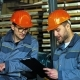 Professional Metalworkers Working at the Factory Storage Together - VideoHive Item for Sale