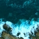 Aerial: The Sea Waves Break Against the Rocks on the Shore. - VideoHive Item for Sale