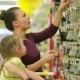 Smiling Mother and Daughter at the Supermarket A Daughter Helps Her Mother Choose an Adhesive Tape - VideoHive Item for Sale