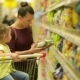 Mother and Daughter Shopping in Supermarket. They Are Buying a Breakfast Flakes. A Daughter Sitting - VideoHive Item for Sale