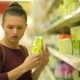 Young Women Chooses Wipes From Supermarket Shelf. A Girl with Caucasian Appearance Makes Purchases - VideoHive Item for Sale