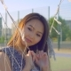 Asian Girl with Beautiful Smile and Long Hair Posing in Front of Camera - VideoHive Item for Sale