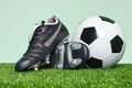 Football or Soccer boots and ball on grass - PhotoDune Item for Sale