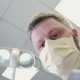 Doctor in a Mask Is Approaching To Patient and Beginning Surgery in Dentistry - VideoHive Item for Sale