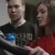 Cute Girl Hardly Working on Exercise Bike and Guy Come To Offer Assistance - VideoHive Item for Sale