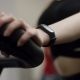 Awesome Girl in Black Sport Wear Hardly Work on Exercise Bike with Focus on Hands in the New Gym - VideoHive Item for Sale