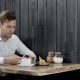Serious Man in Smart Clothes Is Using Mobile Phone in Cafe. Portrait of Handsome Man Typing Messages - VideoHive Item for Sale