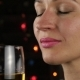 Charming Young Woman Drinking White Wine in a Dark. Festive Atmosphere and Celebration Concept. - VideoHive Item for Sale