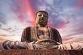 Giant Buddha statue under at sunset - PhotoDune Item for Sale