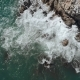 Aerial View of Birds That Start Flying When Ocean Wave Hits the Rocks - VideoHive Item for Sale
