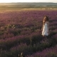 Happy Girl Walking in Lavender Field at Sunset - VideoHive Item for Sale
