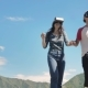 Smile Happy Couple Getting Experience Using VR-headset Glasses of Virtual Reality with Sky and Cloud - VideoHive Item for Sale